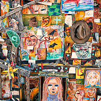 This is a detail from the outside of a flea market booth outside of Santa Fe, New Mexico.  It is festooned with a dazzling and bewildering array of interesting art and objects, from bits of dried macaroni to electronic circuit boards and much, much more.  A visual feast!