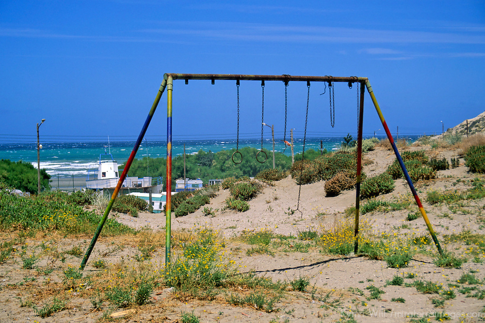 South America, Argentina, Valdes Peninsula. A swingset awaits children.