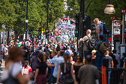 London, August 9th 2014. Tens of thousands of Palestinians and their supporters march along London's Oxford Street towards the US embassy and Hyde Park.