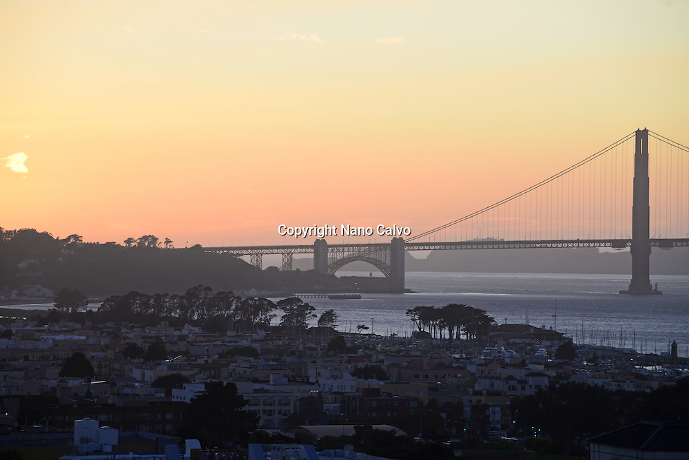 View of San Francisco and Golden Gate Bridge at sunset.