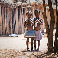 Two little girls in a rural village on the road between Benguela and Lubango