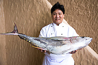 Food in the Philippines usually means fresh seafood.  Here a Filipino chef shows off his catch of the day - a giant yellowfin tuna caught by one of the local fishermen and delivered fresh to the door of the restaurant.