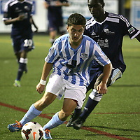 The Hammerheads' Manu Aparicio attempts to dribble past a Harrisburg defender. (Jason A. Frizzelle)