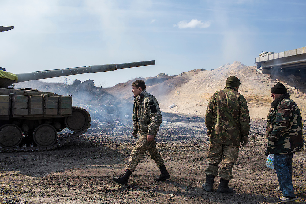PERVOMAISKE, UKRAINE - MARCH 20, 2015: Members of the Dnipro-1 battalion, a pro-Ukrainian militia, inspect a tank with engine trouble at one of the group's bases known as The Bridge near ongoing battles for the town of Pisky in Pervomaiske, Ukraine. CREDIT: Brendan Hoffman for The New York Times