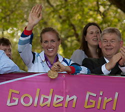 © Licensed to London News Pictures. 19/08/2012. Penzance, UK. Helen Glover, the first winner of a Gold Medal at 2012 London Olympic games for Team GB parades through the streets of her home town. Photo credit: Ashley Hugo/LNP