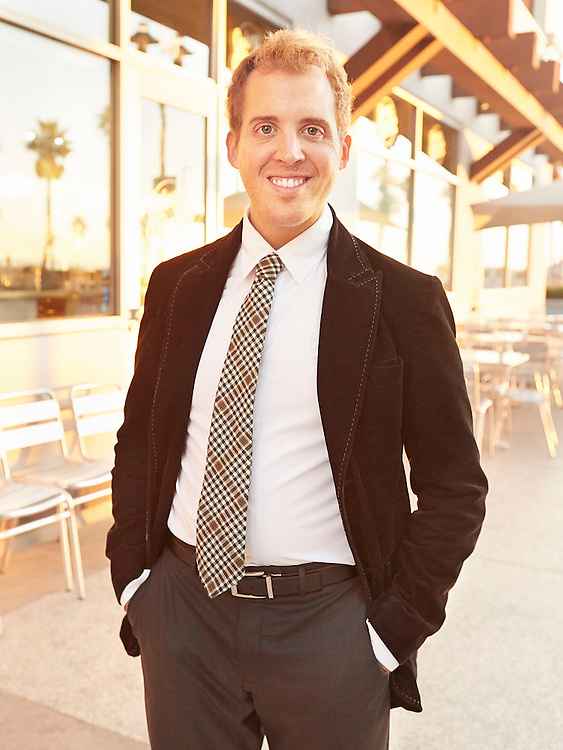 Portrait photograph of smiling entrepreneur in Southern California during sunset