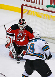 February 20, 2008; Newark, NJ, USA;  New Jersey Devils goalie Martin Brodeur (30) makes a save on a shot by San Jose Sharks center Joe Thornton (19) during the third period at the Prudential Center in Newark, NJ.  The Devils beat the Sharks 3-2.