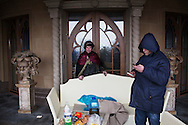 Anti-governement protester Petro Oleïnik (L), a grocer from Lviv, guards one entrance of the lavish mansion as  Kiev's people roam Mezhyhirya, the sprawling President Yanukovych's residence compound on February 23, 2014 in Kiev, Ukraine.