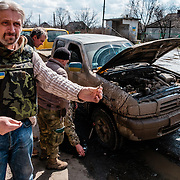 "Valeriy Garagutz - journalist and co-founder of ""Litsa"" newspaper in Dnipropetrovsk. The pro-Russian administration offer $10 000 US dollars for his head. He is showing me what blow-up the military pickup, a shrapnel from a mortar."