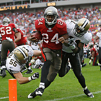 BRENDAN FITTERER | Times (11/30/2008 Tampa) Bucs running back Cadillac Williams (24) slams into (41) Roman Harper as he crosses the goal line for a third quarter touchdown.  Tampa Bay Buccaneers vs. New Orleans Saints.