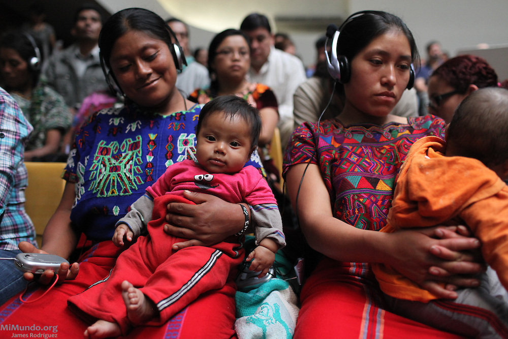 Ixil Mayan women receive radio transmitters for simultaneous translation between Spanish to Ixil. Guatemala City, Guatemala. May 9, 2013.