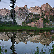 ID00438-00...IDAHO - Dawn light at Alice Lake in the Sawtooth Wilderness Area.
