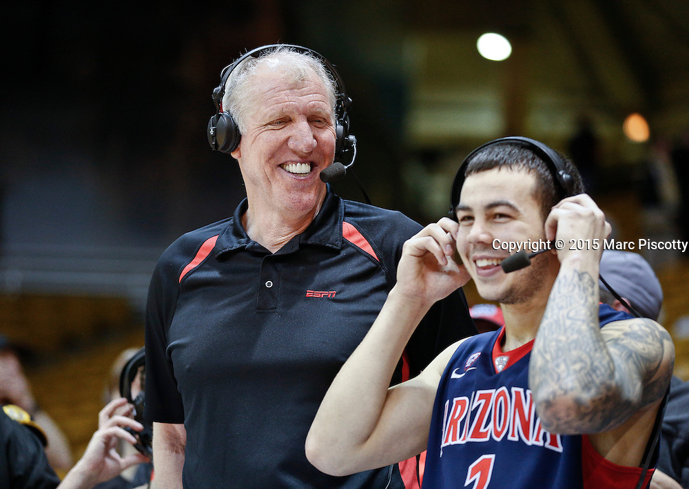 SHOT 2/26/15 10:07:25 PM - NBA great Bill Walton interviews Arizona's Gabe York #1 after a win over Colorado in their regular season Pac-12 basketball game at the Coors Events Center in Boulder, Co. Arizona won the game 82-54.<br /> (Photo by Marc Piscotty / &copy; 2015)