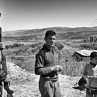 Turkish men beside the border with Syrian in the town of Hacipasa, Turkey, Sunday, March 18, 2012. The number of Syrian refugees in Turkey is now about 17,000. March 2012.