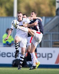 Dumbarton's Andy Graham and Falkirk's David McCracken.<br /> Falkirk 1v 1 Dumbarton, Scottish Championship game played 20/9/2014 at The Falkirk Stadium .