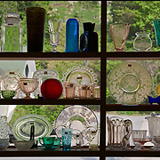 Berkeley Springs, West Virginia (famous for Hot springs.) Glassware in window of antique shop in center of the historic resort town.  NO PROPERTY RELEASE.