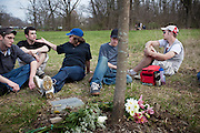 Cindy West (center) sits at a memorial site for her son, Christopher Thiel, with his friends in Dublin, Ohio. Chris and his girlfriend Kelly Armbruster died of a heroin overdose on May 3, 2008. On what would have been Chris' 23rd birthday, April 18, 2009, his friends and family gathered at the memorial site to celebrate his life.