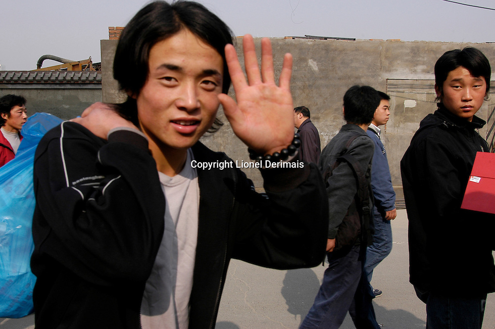 Young Chinese workers arriving from the provinces in Dongzhimen, Beijing, China.