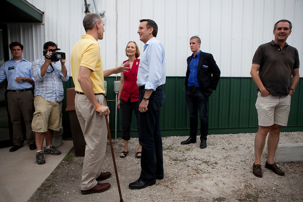 Republican presidential hopeful Tim Pawlenty, center, campaigns on Tuesday, August 9, 2011 in Humboldt, IA.