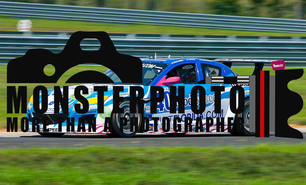 Dempsey &amp; Foster drivers of the No. 40 Mazda RX-8 speed down straight away during qualifying Friday, July 22, 2011, at New Jersey Motorsports Park in Millville New Jersey.<br /> <br /> Special to Monsterphoto/SAQUAN STIMPSON.