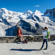 Left to right are the peaks of: Monte Rosa massif / Dufourspitze(4634 m / 15,203 ft, second-highest mountain of the Alps and highest of Switzerland), Liskamm, Castor, Pollux, Breithorn, in the Pennine/Valais Alps, Europe. Below is the Gorner Glacier. In Zermatt, the Gornergrat rack railway (GGB) takes you to a spectacular ridge (at 3135 m or 10,285 ft) between Gornergletscher and Findelgletscher, with views of more than twenty 4000-meter-high peaks. Gornergrat train, opened in 1898, climbs almost 1500 m or 4900 ft via Riffelalp and Riffelberg. This image was stitched from multiple overlapping photos.