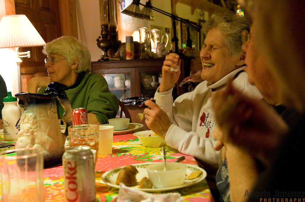 """Date: 1/08/09.Desk: STL.Slug: WOMYN.Assign ID: 30074969A..Women gather for a potluck dinner at Alapine, a """"womyn's land"""" or lesbian intentional community, in rural northeast Alabama. Pictured are, from left, Emily Greene, 62, and Jean Adele, 72. ..(*the exact town/location of the community cannot be revealed in the caption or article, per agreement with the subjects)..Photo by Angela Jimenez for The New York Times .photographer contact 917-586-0916"""