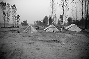 3 tents stand on land where houses were washed away in the recent floods. People slowely return to their land in hopes to rebuild their lives. After constant attacks of Taliban millitants the Swat valley recently was badly hit by flood waters and causing major damage in this already troublesome region. Mingora, Pakistan, 2010