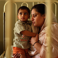 Patients recover from a variety of ailments at the Children's Hospital at the Pakistan Institute of Medical Sciences in Islamabad, Pakistan, Sept. 18, 2007.