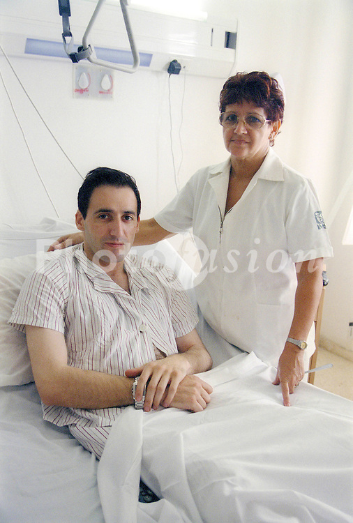 Nurse with patient in the Sala Especial at Hermanos Ameijeiras Hospital; Havana Cuba,