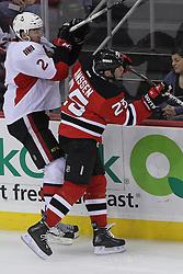 Apr 7; Newark, NJ, USA; New Jersey Devils right wing Cam Janssen (25) hits Ottawa Senators defenseman Jared Cowen (2) during the second period at the Prudential Center.