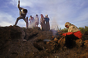 Seri's honey hunting. There are about 750 Seris left living in two communities on the Sea of Cortez, Puenta Chueca and Disemboque. They are known as the last hunter-gathers in North America. The live off the desert and fish for themselves, not to sell.  Here the Barnett family (Ignacio and Francisco) go into the desert near their home in Puenta Chueca to find honey. They locate a bee nest under in a crevice in some rocks, they smoke out the bees, and get the honey.