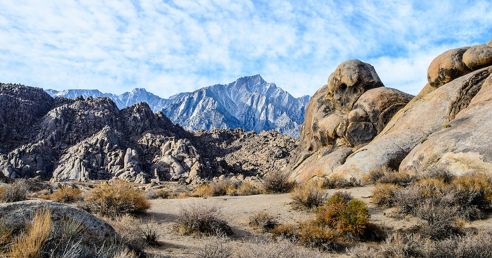 Since the 1920's,this location has served as a background to hundreds of movies. Lone Pine peak and the Sierra Nevada mountains are in the background. Alabama Hills, near Lone Pine California.