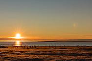 Sunrise on Kaktovik cementary on Barter Island in Arctic National Wildlife Refuge in the Far North of Alaska. Autumn. Morning.