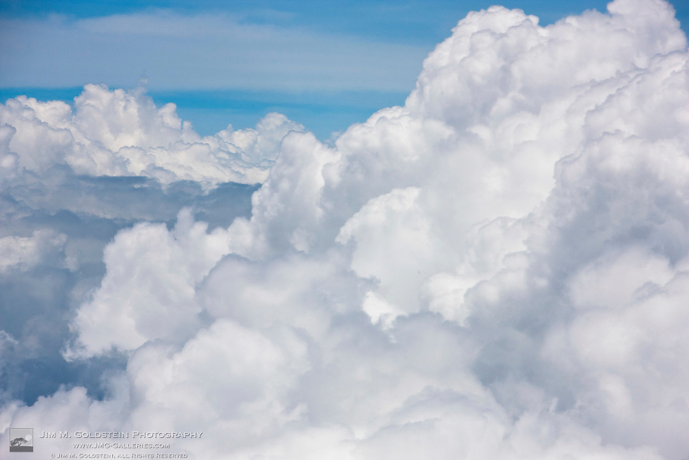 Cumulus clouds as seen from high above the tropical coastline of Costa Rica