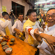 Mr. Wong is congratulated by his friends and Associates after he was chosen to lead next year's celebration of the nine Emperor Festival in Penang, Malaysia.
