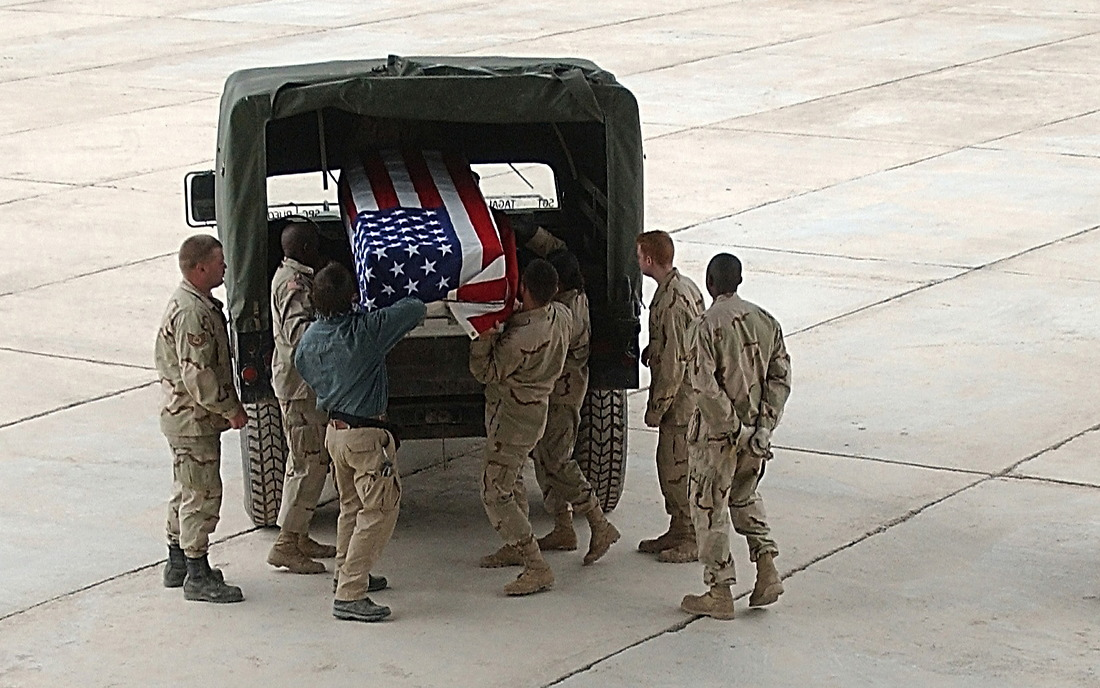 The body of a fallen Navy Seal is ready to be loaded onto a C-17 in Karshi khanabad Uzbekistan destine for Ramstien AFB Germany on March 29, 2002 in support of Operation Enduring Freedom. — © Jeremy T. Lock, SSgt, USAF/