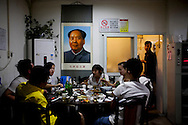Forty years after his death, Mao Ts&eacute;-Tung is still framed and hung on walls around China. Pictures in large and gold-colored frames or simple printed in big sheets of paper are visible in restaurants, groceries or souvenirs shops, hidden alleys, homes and living rooms. Mao&rsquo;s face appears between pictures of traditional Chinese dishes, lists of food prices, wall fans, mirrors or other photographs - Mao Tse Tung.<br /> May 2016 - China.