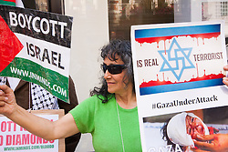 London, August 1st 2014. A small group of Palestinian supporters protest outside De Beers in Mayfair against the company's connections with the Israeli diamond cutting industry, and calling for a boycott of all Israeli goods.