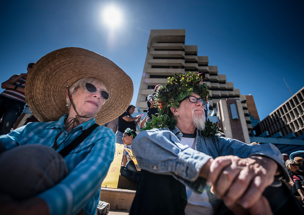 rer042217a/metro/04.22.2017/Roberto E. Rosales <br /> Thousands attended the Albuquerque Earth Day celebration as well as marched for Science Saturday afternoon in downtown. Many came holding signs with messages and donned costumes dealing with mother earth.  Pictured are friends Edie Scott(Cq),left, and Richard Tuthill(Cq) as they listen to scientists speak to the crowd. <br /> Albuquerque, New Mexico(Roberto E. Rosales/Albuquerque Journal)
