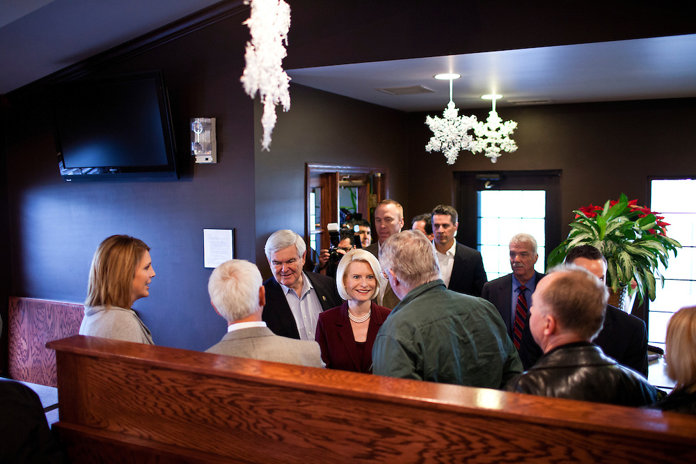 Republican presidential candidate Newt Gingrich and his wife, Callista Gingrich, arrive at Tish's Restaurant on Saturday, December 31, 2011 in Council Bluffs, IA.