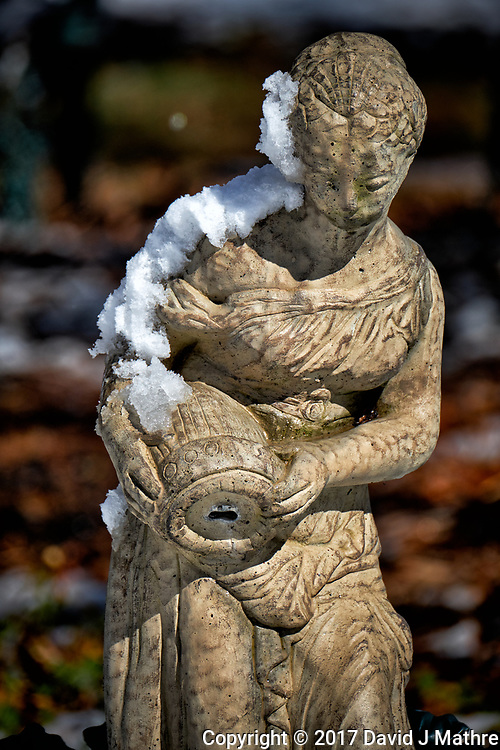 Fountain statue after a winter snowstorm. Image taken with a Fuji X-T2 camera and 100-400 mm lens (ISO 200, 290 mm, f/5.6, 1/1900 sec).