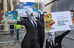 """St James, London, May 12th 2016. Protesters from transparency and accountability group One demonstrate demanding """"a new, global standard of transparency that could end the corruption that keeps people poor"""". PICTURED: Protesters outside the conference security cordon."""