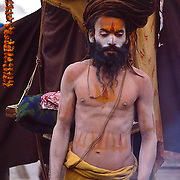 A Shaivite sadhu, or ascetic, stands at Pasupatinath Temple in Kathmandu, Nepal, during the festival of Shiva Ratri, or Shiva's birthday.