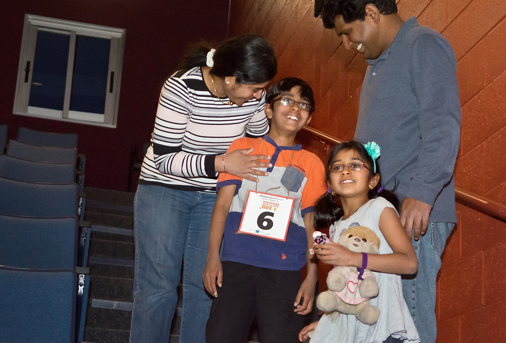 Akilan Sankaran, second from left, a Manzano Day School 4th grader, celebrates winning the 2017 New Mexico Spelling Bee with his mother Sridevi Kumaravelu, left, father Siva Rajamanickam, right, and sister Sowmya Sankaran, 7, at Sandia Prep, Saturday, March 18, 2017. (Marla Brose/Albuquerque Journal)