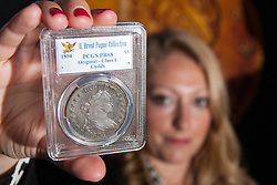 London, March13th 2015. Ahead of the first sale of the D. Brent Pogue rare United States Federal coin  collection sale to be held at Sotheby's  New York. The collection is composed of over 650 gold, silver, and copper coins, and is expected to be the most valuable collection of coins ever sold. PICTURED: The 1804 Silver Dollar originally presented to the Sultan of Muscat in 1835. It is anticipated to fetch up to $10 million at auction