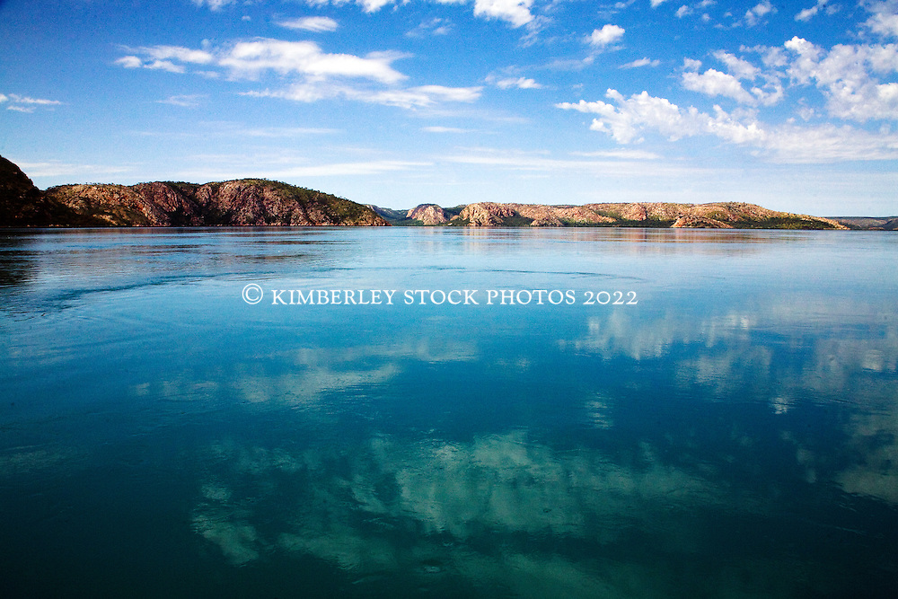 Clouds reflect in still water in Dugong Bay on the Kimberley coast of Western Australia.