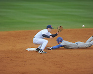Ole Miss' Lance Wilson (6) vs. Memphis' Tucker Tubbs (8) is safe at second at Oxford-University Stadium in Oxford, Miss. on Tuesday, February 26, 2013. Memphis won 4-3. Ole Miss falls to 7-1.