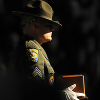 A member of the Montana Highway Patrol honor guard carries the ashes of trooper David DeLaittre in Dec. 2010. DeLaittre was shot during a traffic stop near Three Forks, Mont.