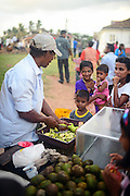 Ambulant food seller in UNESCO World Heritage, Galle Fort, during Binara Full Moon Poya Day.