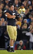 Manti Te'o (5) adjusts his helmet in the second quarter against USC at Notre Dame Stadium.